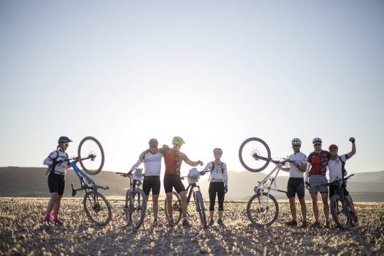 silhouette of cyclists in desert