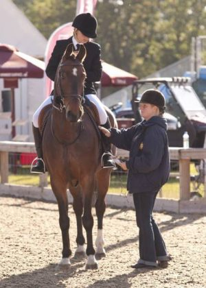 Caroline Colwell helping in the warm up ring