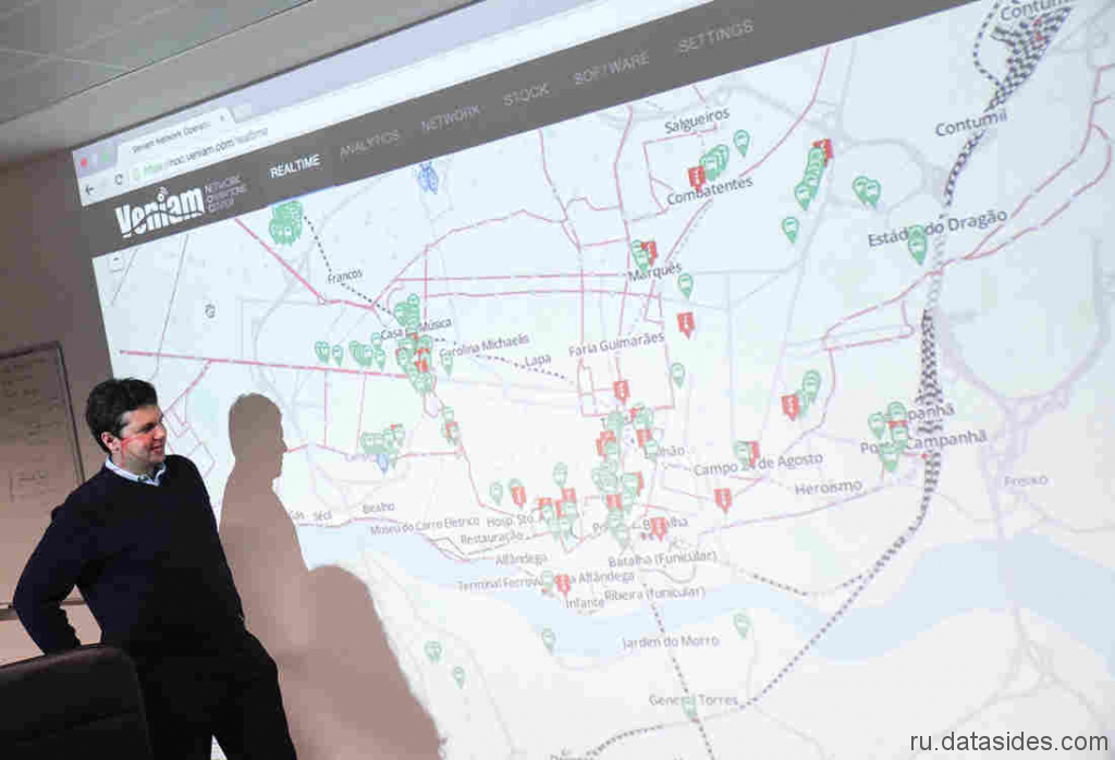 Joao Barros, Director General of Veniam, demonstrates wi – fi router tracking map in Portu city busses.