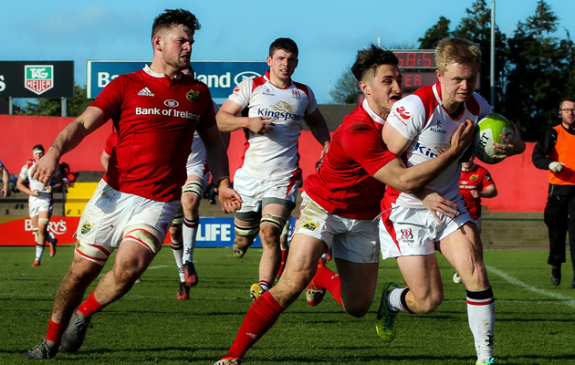 The academy's Greg O'Shea with a try-saving tackle in Irish Independent Park yesterday
