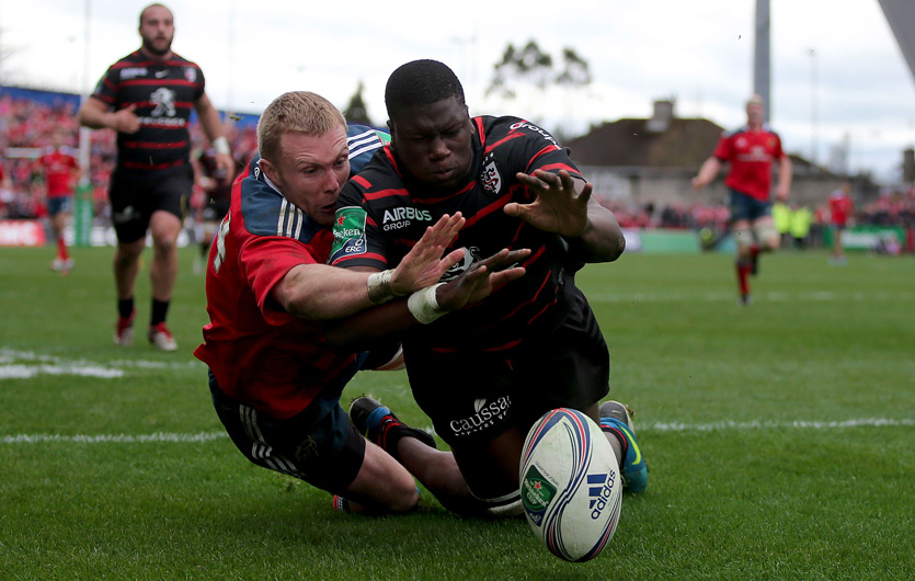 Keith Earls and Yacouba Camara compete for possession in the 2014 quarter final at Thomond Park.