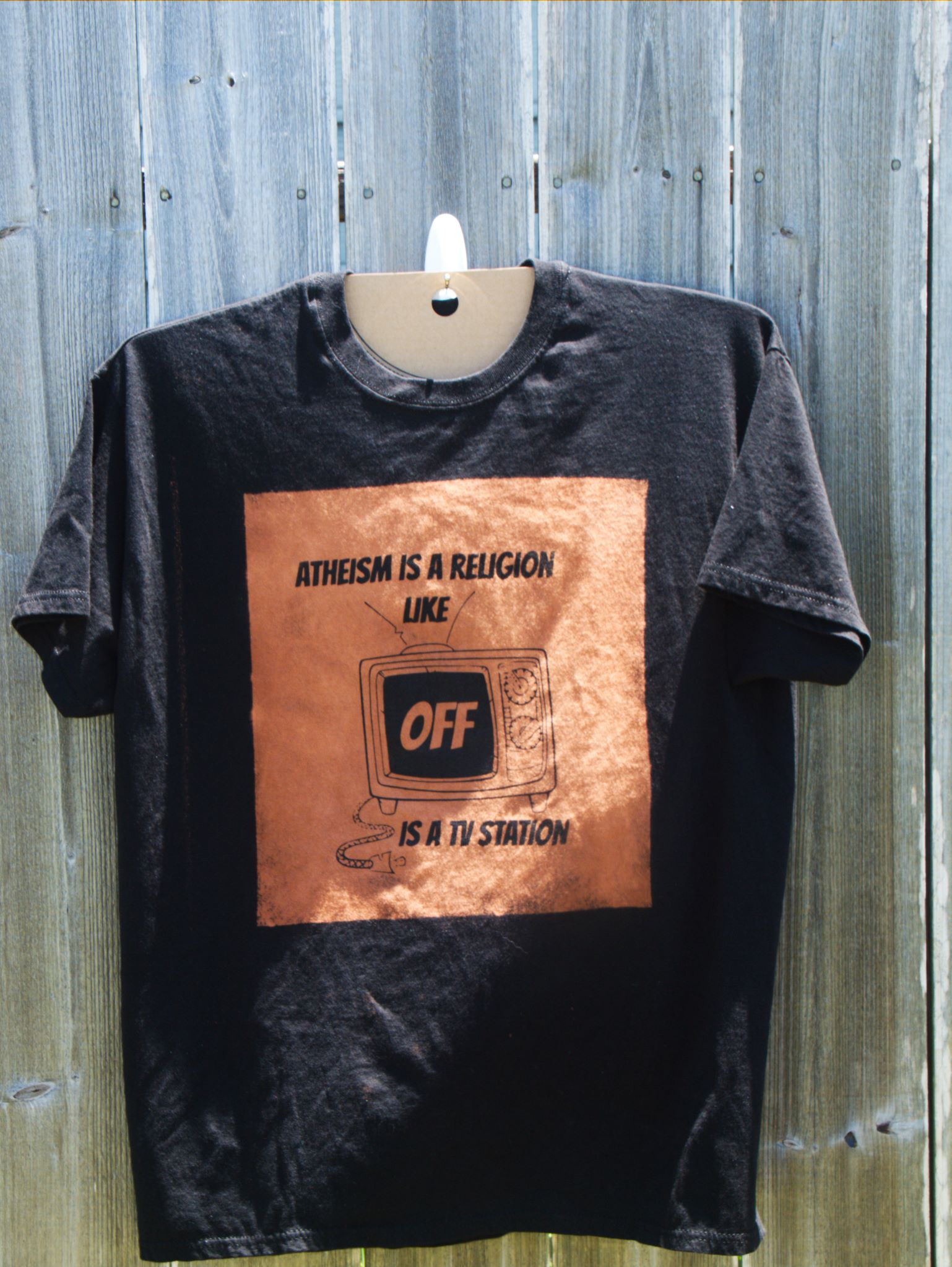 Atheism is a religion like OFF is a TV station discharge ink tee shirt example