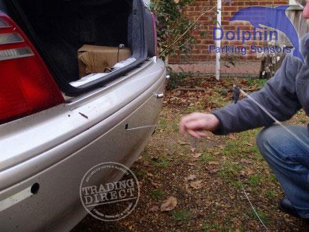 Feeding sensors through rear bumper