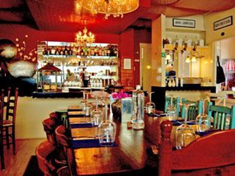 Reserveer een tafel bij Restaurant Potjandorie! Eetkamer in Apeldoorn