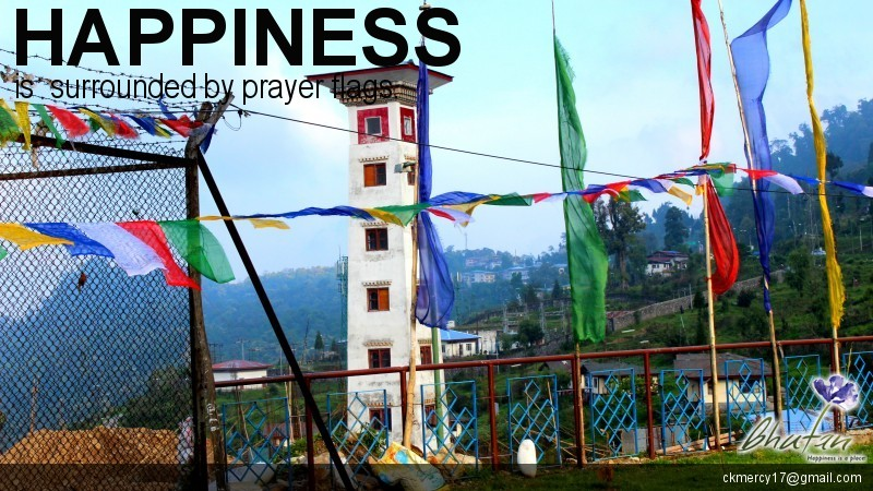 Happiness is  surrounded by prayer flags.