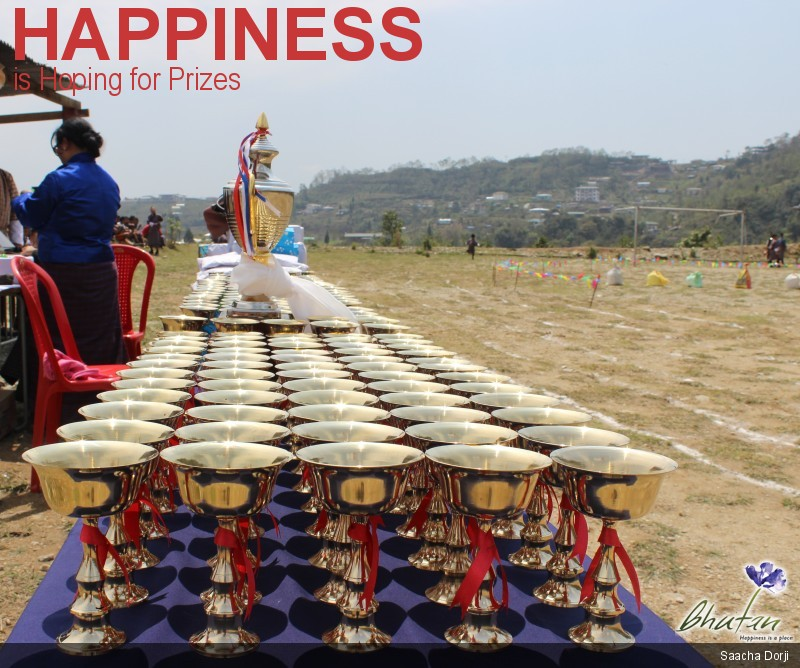 Happiness is Hoping for Prizes