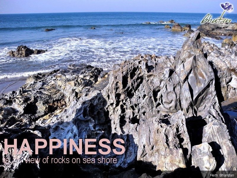 Happiness is       view of rocks on sea shore