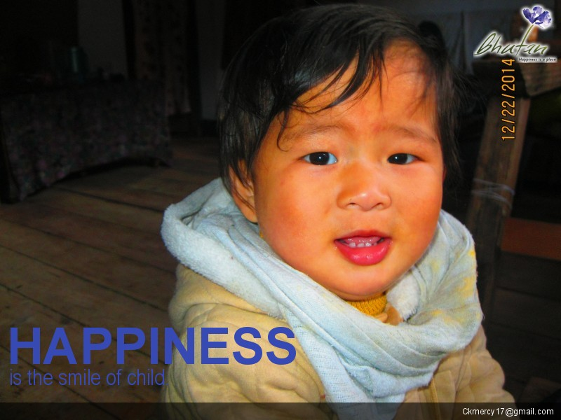 Happiness is the smile of child.