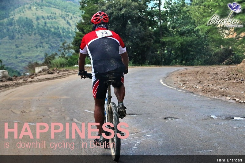 Happiness is   downhill  cycling   in Bhutan