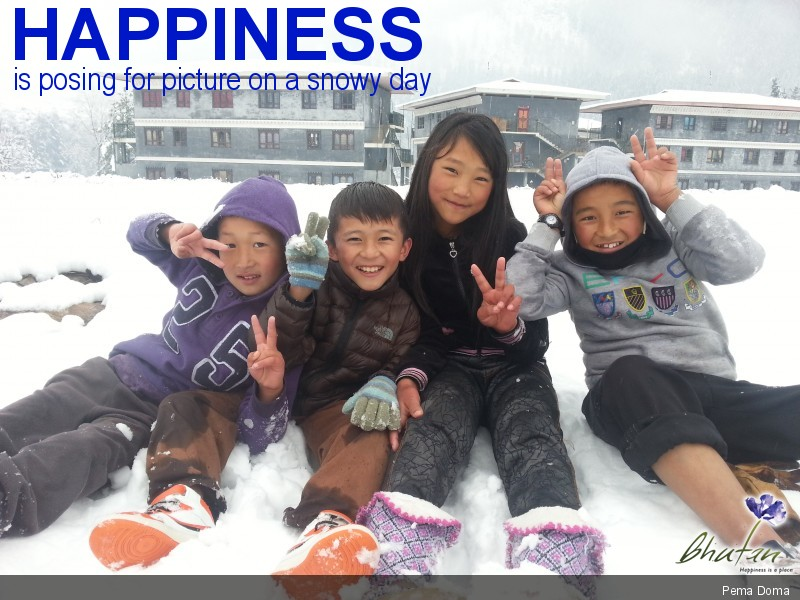 Happiness is posing for picture on a snowy day