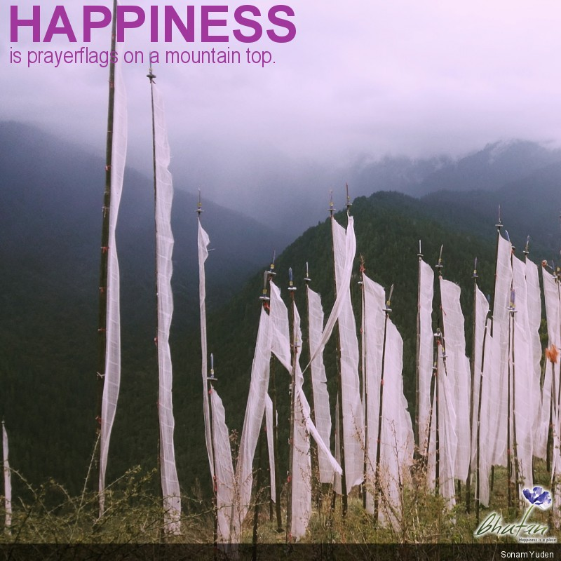 Happiness is prayerflags on a mountain top.