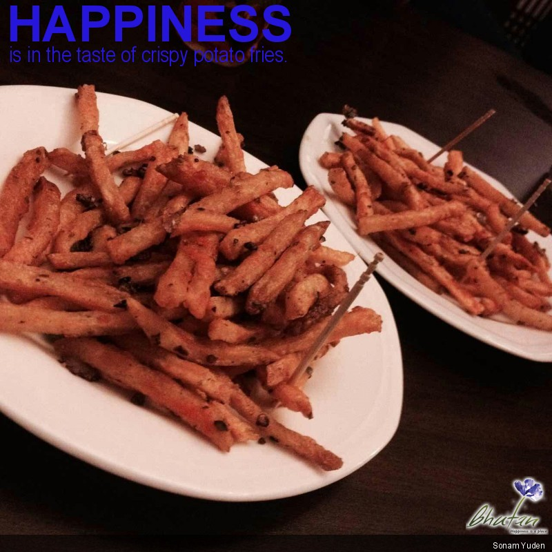 Happiness is in the taste of crispy potato fries.