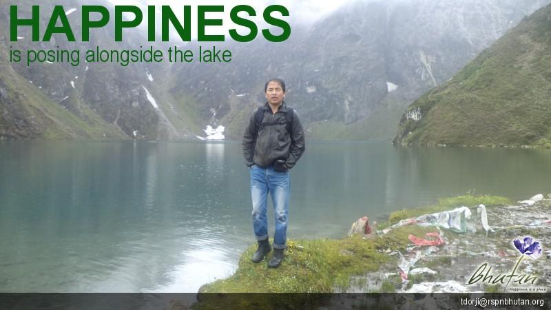 Happiness is posing alongside the lake