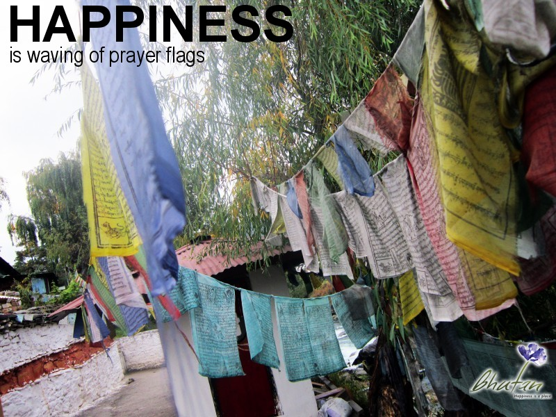 Happiness is waving of prayer flags