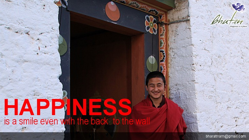 Happiness is a smile even with the back  to the wall