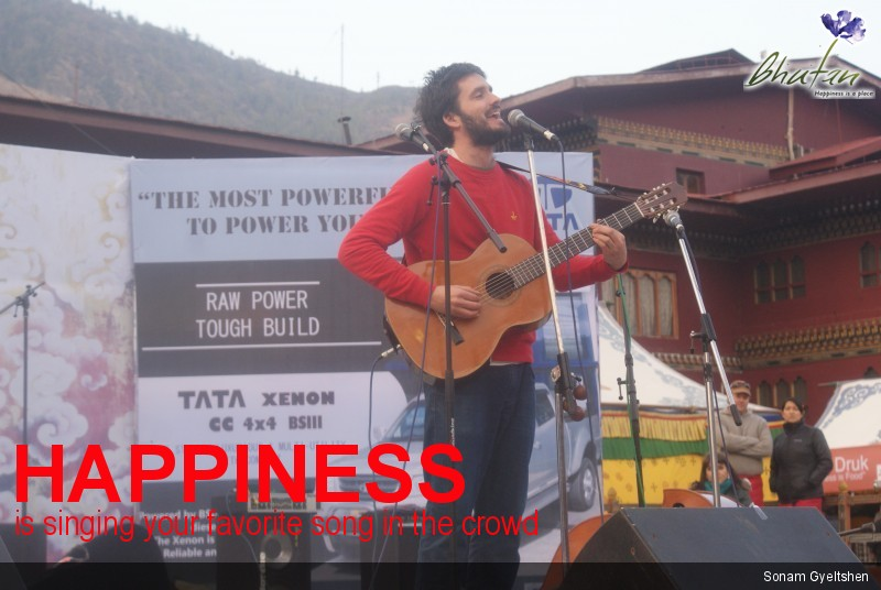 Happiness is singing your favorite song in the crowd