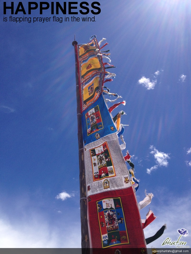 Happiness is flapping prayer flag in the wind.