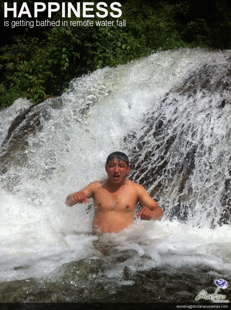 Happiness is getting bathed in remote water fall