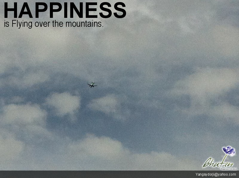 Happiness is Flying over the mountains.