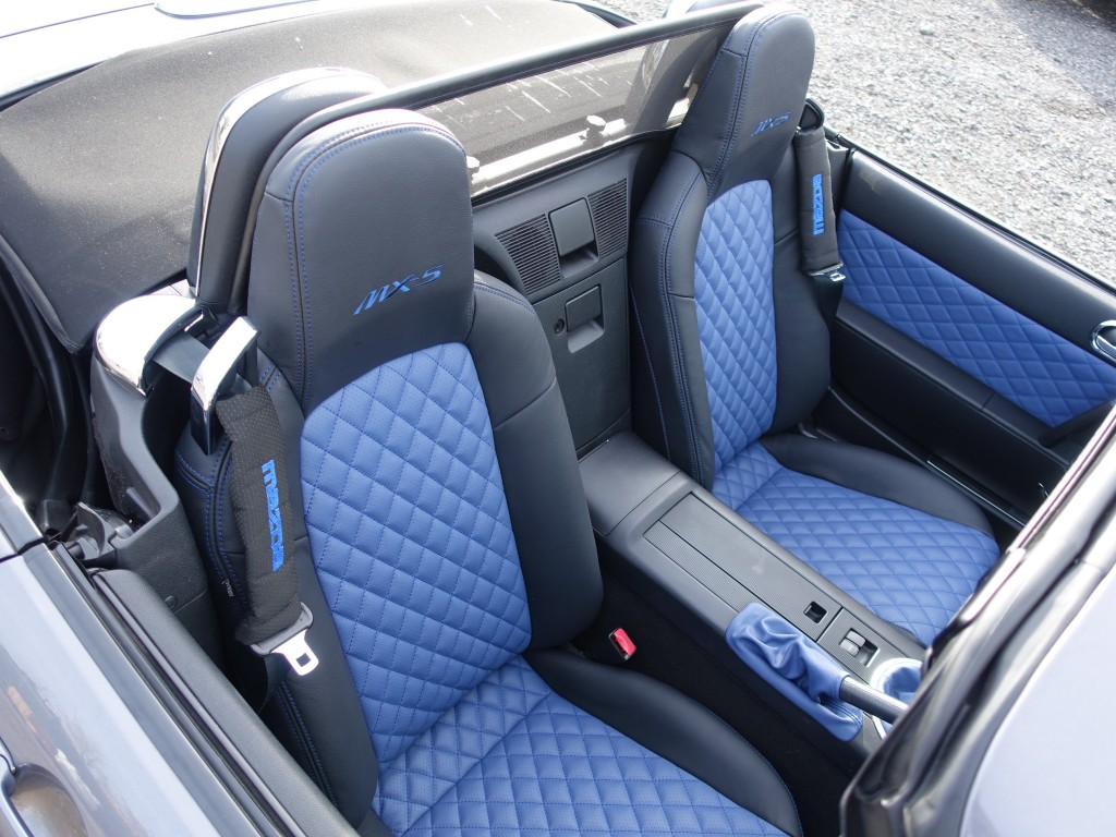 Black leather with blue leather centres and blue diamond stitching.