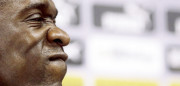 Dutch soccer player Seedorf reacts during a news conference in Rio de Janeiro