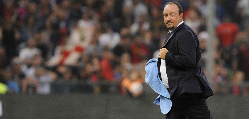 Napoli's Rafa Benitez runs on the pitch during the break in the Italian Serie A soccer match against Genoa at the Marassi stadium in Genoa