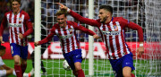Atletico Madrid's Belgian forward Yannick Ferreira Carrasco (R) celebrates after scoring a goal during the UEFA Champions League final football match between Real Madrid and Atletico Madrid at San Siro Stadium in Milan, on May 28, 2016. / AFP / PIERRE-PHILIPPE MARCOU        (Photo credit should read PIERRE-PHILIPPE MARCOU/AFP/Getty Images)