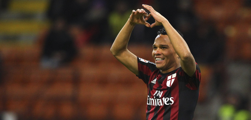 MILAN, ITALY - JANUARY 17:  Carlos Bacca of AC Milan celebrates after scoring the opening goal during the Serie A match between AC Milan and ACF Fiorentina at Stadio Giuseppe Meazza on January 17, 2016 in Milan, Italy.  (Photo by Marco Luzzani/Getty Images)