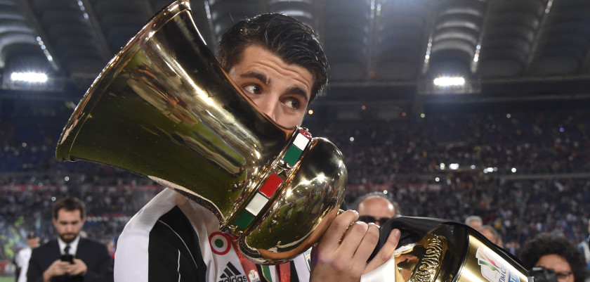 Juventus' forward from Spain Alvaro Morata kisses the trophy after winning the Italian Tim Cup final football match AC Milan vs Juventus on May 21, 2016 at the Olympic Stadium in Rome.  Juventus won 0-1 in the extra time.     AFP PHOTO / TIZIANA FABI / AFP / TIZIANA FABI        (Photo credit should read TIZIANA FABI/AFP/Getty Images)