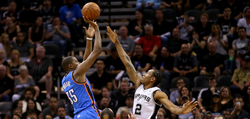 SAN ANTONIO, TX - MAY 21:  Kevin Durant #35 of the Oklahoma City Thunder shoots over Kawhi Leonard #2 of the San Antonio Spurs in the first half in Game Two of the Western Conference Finals during the 2014 NBA Playoffs at AT&T Center on May 21, 2014 in San Antonio, Texas. NOTE TO USER: User expressly acknowledges and agrees that, by downloading and or using this photograph, User is consenting to the terms and conditions of the Getty Images License Agreement.  (Photo by Ronald Martinez/Getty Images)