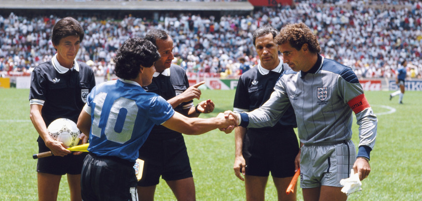 Diego Maradona of Argentina #10 shakes hands with Peter Shilton of England under the watching eye of referee Ali Bin Nasser (c) before the 1986 FIFA World Cup Quarter Final on 22 June 1986 at the Azteca Stadium in Mexico City, Mexico.   (Photo by David Cannon/Allsport/Getty Images)