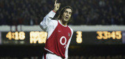 LONDON - JANUARY 10:  Robert Pires of Arsenal celebrates scoring the third goal for Arsenal during the FA Barclaycard Premiership match between Arsenal and Middlesbrough at Highbury on January 10, 2004 in London.  (Photo by Ben Radford/Getty Images) *** Local Caption *** Robert Pires