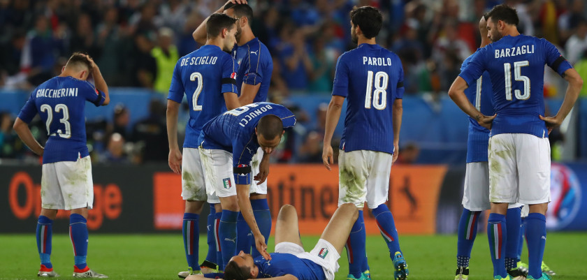 BORDEAUX, FRANCE - JULY 02:  Italy players show their dejeciton after their defeat through the penalty shootout during the UEFA EURO 2016 quarter final match between Germany and Italy at Stade Matmut Atlantique on July 2, 2016 in Bordeaux, France.  (Photo by Alexander Hassenstein/Getty Images)