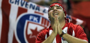 A Red Star fan clasps his hands together during a Champions League Third Qualifying Round, Second Leg soccer match against Glasgow Rangers in Belgrade, 28 August 2007.    AFP PHOTO / ANDREJ ISAKOVIC (Photo credit should read ANDREJ ISAKOVIC/AFP/Getty Images)