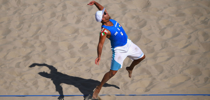 RIO DE JANEIRO, BRAZIL - AUGUST 06:  Adrian Carambula Raurich of Italy serves during the Men's Beach Volleyball preliminary round Pool A match against Clemens Doppler and Alexander Horst of Austria on Day 1 of the Rio 2016 Olympic Games at the Beach Volleyball Arena on August 6, 2016 in Rio de Janeiro, Brazil.  (Photo by Shaun Botterill/Getty Images)