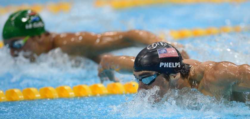 US swimmer Michael Phelps (R) and South Africa's Chad Le Clos (L) compete in the men's 200m butterfly final during the swimming event at the London 2012 Olympic Games on July 31, 2012 in London.  AFP PHOTO / CHRISTOPHE SIMON        (Photo credit should read CHRISTOPHE SIMON/AFP/GettyImages)