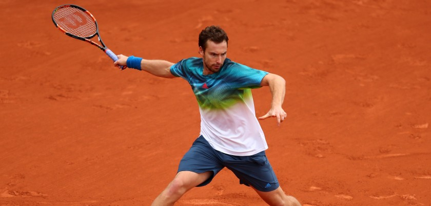 PARIS, FRANCE - JUNE 01:  Ernests Gulbis of Latvia hits a forehand during the Men's Singles fourth round match against David Goffin of Belgium on day eleven of the 2016 French Open at Roland Garros on June 1, 2016 in Paris, France.  (Photo by Julian Finney/Getty Images)