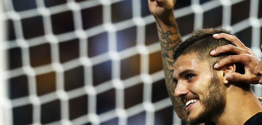Inter Milan's forward Mauro Emanuel Icardi from Argentina (L) celebrates after scoring with his teammate during the Italian Serie A football match Inter Milan Vs Juventus on September 18, 2016 at the 'San Siro Stadium' in Milan.  / AFP / MARCO BERTORELLO        (Photo credit should read MARCO BERTORELLO/AFP/Getty Images)