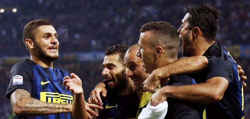 Inter Milan's forward Ivan Perisic from Croatia (2R) celebrates after scoring with Inter Milan's forward Mauro Emanuel Icardi from Argentina (L) during the Italian Serie A football match Inter Milan vs Juventus on September 18, 2016 at the 'San Siro Stadium' in Milan. / AFP / MARCO BERTORELLO        (Photo credit should read MARCO BERTORELLO/AFP/Getty Images)