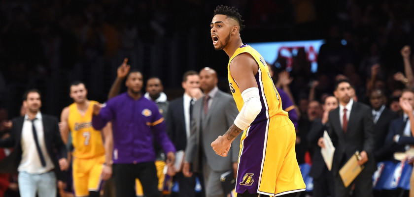 LOS ANGELES, CA - OCTOBER 26:  D'Angelo Russell #1 of the Los Angeles Lakers reacts to a three pointer from Jordan Clarkson #6 during a 120-114 season opening win over the Houston Rockets at Staples Center on October 26, 2016 in Los Angeles, California.  NOTE TO USER: User expressly acknowledges and agrees that, by downloading and or using this photograph, User is consenting to the terms and conditions of the Getty Images License Agreement.  (Photo by Harry How/Getty Images)