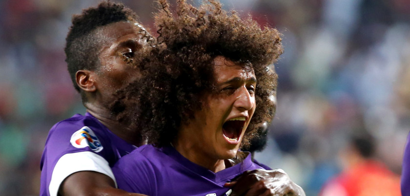 UAE's al-Ain's Omar Abdulrahman celebrates with his teammate Asamoah Gyan (L) after scoring the second goal during their AFC Champions League football match (knockout stage of the first leg) between UAE's al-Jazira and  UAE's al-Ain on May 6, 2014 at Sheikh Mohammed Bin Zayed Stadium in Abu Dhabi. AFP PHOTO/MARWAN NAAMANI        (Photo credit should read MARWAN NAAMANI/AFP/Getty Images)