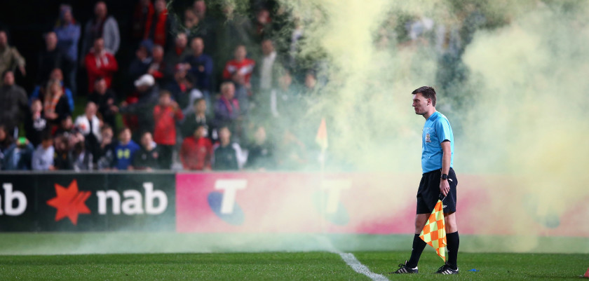 SYDNEY, AUSTRALIA - SEPTEMBER 01:  The assistant referee watches on in smoke from a flare thrown on the field during the FFA Cup Round of 16 match between Rockdale City Suns and Melbourne Victory at WIN Jubilee Stadium on September 1, 2015 in Sydney, Australia.  (Photo by Mark Kolbe/Getty Images)