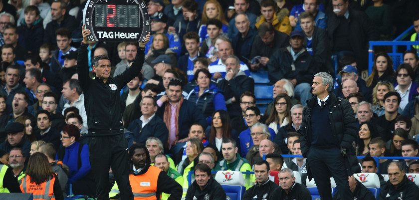 Manchester United's Portuguese manager Jose Mourinho (R) checks on the time given for injuries by fourth official Andre Marriner (L)  during the English Premier League football match between Chelsea and Manchester United at Stamford Bridge in London on October 23, 2016. / AFP / Glyn KIRK / RESTRICTED TO EDITORIAL USE. No use with unauthorized audio, video, data, fixture lists, club/league logos or 'live' services. Online in-match use limited to 75 images, no video emulation. No use in betting, games or single club/league/player publications.  /         (Photo credit should read GLYN KIRK/AFP/Getty Images)