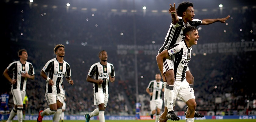 Juventus' forward Paulo Dybala from Argentina (R) celebrates after scoring with Juventus' midfielder Juan Cuadrado (top) from Colombia during the Italian Serie A football match Juventus vs Udinese on October 15, 2016 at the 'Juventus Stadium' in Turin.   / AFP / MARCO BERTORELLO        (Photo credit should read MARCO BERTORELLO/AFP/Getty Images)