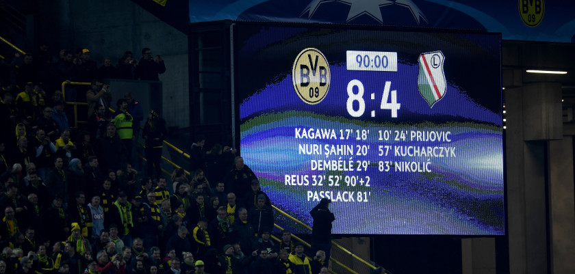 The picture shows the stadium display with the final score of 8-4 after the Champions League football match between Borussia Dortmund and Legia  Warszawa on November 22, 2016 in Dortmund. / AFP / PATRIK STOLLARZ        (Photo credit should read PATRIK STOLLARZ/AFP/Getty Images)