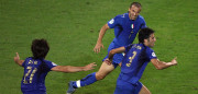 Dortmund, GERMANY:  Italian defender Fabio Grosso (R) celebrates next to Italian forward Alessandro Del Piero (background) and Italian midfielder Andrea Pirlo (L) after scoring the opening goal during the extra-time of the World Cup 2006 semi final football match Germany vs. Italy, 04 July 2006 at Dortmund stadium. Italy won 2 to 0 after the extra-time. AFP PHOTO / VALERY HACHE  (Photo credit should read VALERY HACHE/AFP/Getty Images)