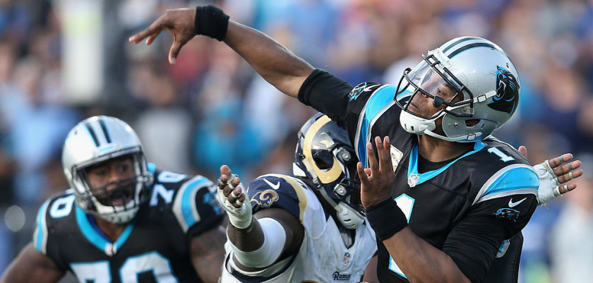 LOS ANGELES, CA - NOVEMBER 06:  Quarterback Cam Newton #1 of the Carolina Panthers gets the ball off before William Hayes #95 of the Los Angeles Rams hits him during the fourth quarter of the game at the Los Angeles Coliseum on November 6, 2016 in Los Angeles, California.  (Photo by Stephen Dunn/Getty Images)