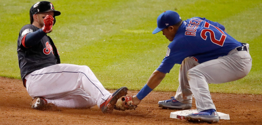 CLEVELAND, OH - NOVEMBER 01:  Addison Russell #27 of the Chicago Cubs tags out Roberto Perez #55 of the Cleveland Indians at second base during the ninth inning in Game Six of the 2016 World Series at Progressive Field on November 1, 2016 in Cleveland, Ohio.  (Photo by Gregory Shamus/Getty Images)