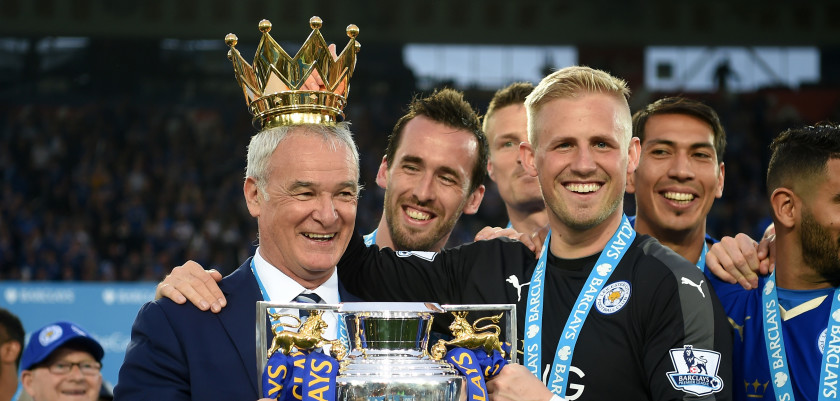 LEICESTER, ENGLAND - MAY 07:  Claudio Ranieri poses with the Premier League Trophy while Kasper Schmeichel puts the crown on the head of the manager as players and staffs celebrate the season champions after the Barclays Premier League match between Leicester City and Everton at The King Power Stadium on May 7, 2016 in Leicester, United Kingdom.  (Photo by Michael Regan/Getty Images)