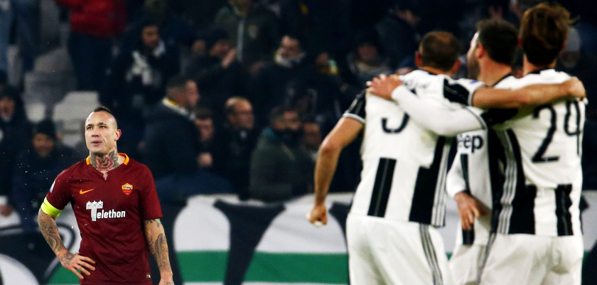 AS Roma's midfielder Radja Nainggolan (L) of Belgium reacts at the end of the Italian Serie A football match Juventus vs As Roma on December 17, 2016 at the 'Juventus Stadium' in Turin.  / AFP / MARCO BERTORELLO        (Photo credit should read MARCO BERTORELLO/AFP/Getty Images)
